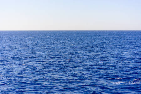 Photo for Background texture of a calm deep blue ocean with ripples on the surface of the seawater, full frame - Royalty Free Image