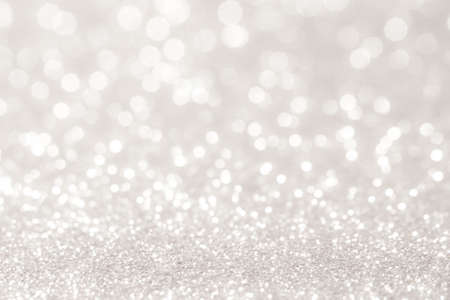 Foto de silver and white bokeh lights defocused. abstract background - Imagen libre de derechos