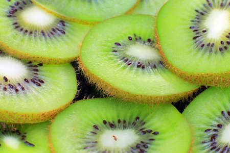 Photo for Lie on a plate of sliced kiwi. Lots of green fruits with bright light in the background as background. - Royalty Free Image