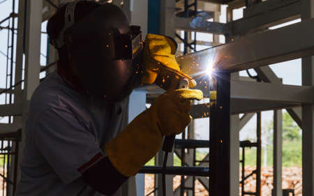 Photo for Welders were welding steel structural by arc welding. - Royalty Free Image