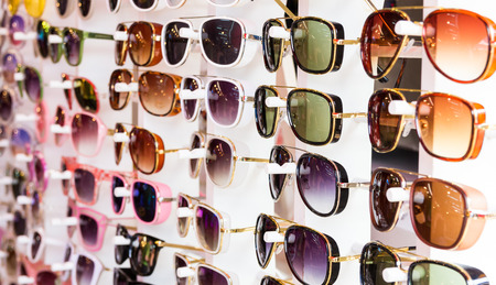 Photo pour fashion glasses in opticians shop - image libre de droit