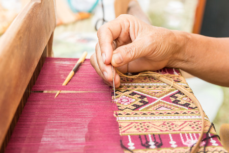 Photo for Woman hand weaving traditional thai silk - Royalty Free Image