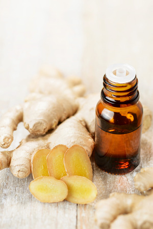 Photo for Ginger essential oil in the amber bottle - Royalty Free Image