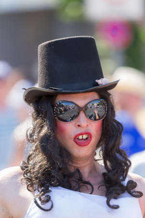 Drag Queen with top hat at Christopher Street Day
