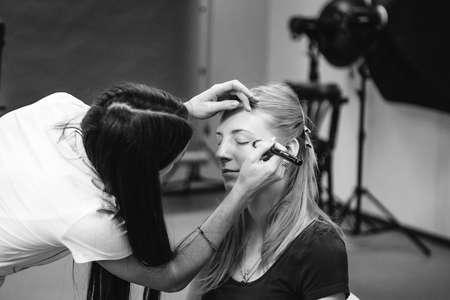 Foto de Makeup artist at work black and white photo - Imagen libre de derechos