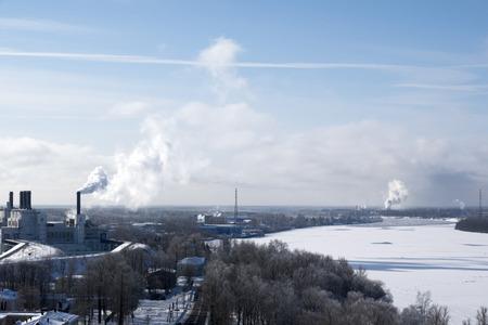 Foto de a winter city and a plant from which smoke comes out - Imagen libre de derechos