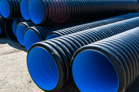 Photo pour Corrugated water pipes of large diameter prepared for laying - image libre de droit