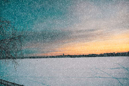 Photo for Winter sunset on the shore of the pond in the snow - Royalty Free Image