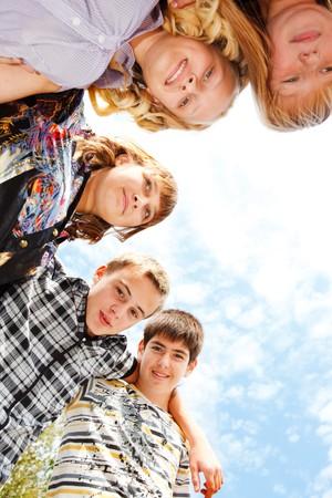 Teens group embracing