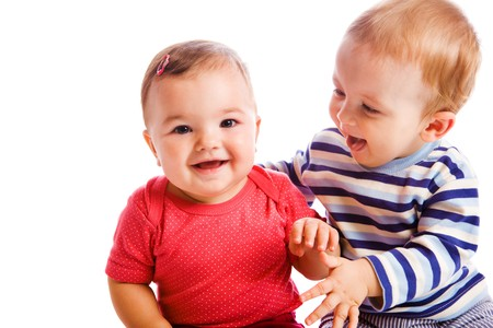 Cheerful babies playing