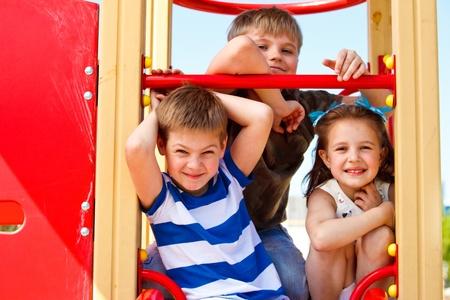 Three elementary aged children in the playground