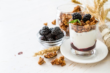 Photo for Breakfast - granola, yogurt, berries, wheat, white wood background, copy space - Royalty Free Image