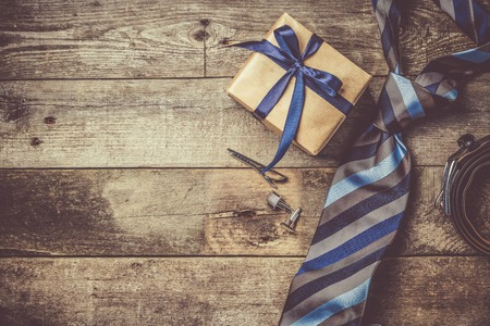 Photo for Fathers day concept - present, tie on rustic wood background - Royalty Free Image