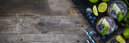 Foto de Blueberry mojito on rustic wood background - Imagen libre de derechos