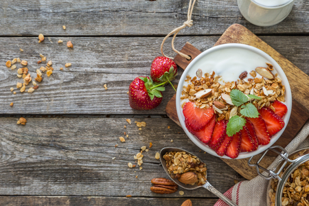 Photo for Breakfast - yogurt with granola and straberries - Royalty Free Image