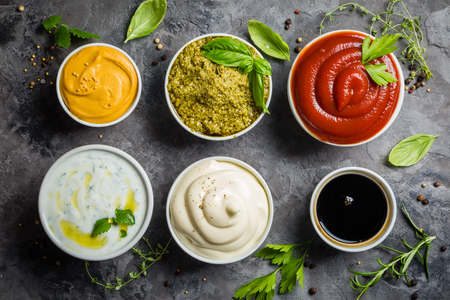 Photo pour Selection of different sauces in bowls - image libre de droit