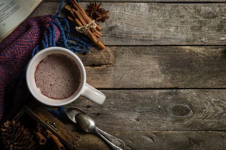 Photo pour Winter hot chocolate on rustic background - image libre de droit