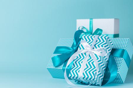 Foto de Christmas decorations - colorful presents on blue background - Imagen libre de derechos