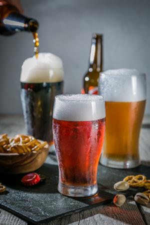Foto de Different types of beer on rustic wood background - Imagen libre de derechos