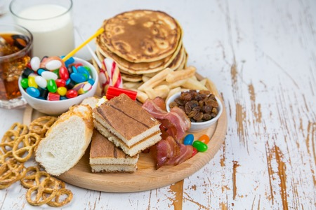 Foto de Selection of food that can cause diabetes, healthcare concept - Imagen libre de derechos