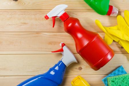 Foto de Cleaning concept - cleaning supplies on wood background - Imagen libre de derechos