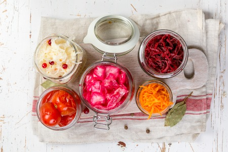 Photo pour Selection of fermented food - carrot, cabbage, tomatoes, beetroot, copy space - image libre de droit