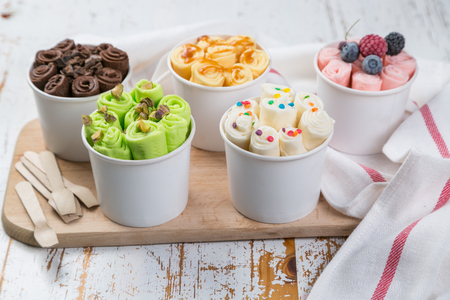 Photo for Selection of different rolled ice creams in cone cups - Royalty Free Image