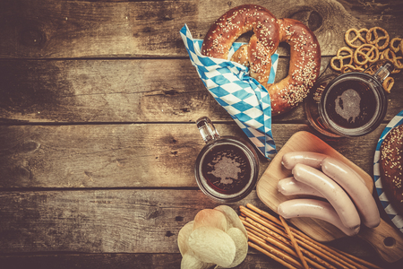 Photo for Oktoberfest concept - traditional food and beer on rustic background - Royalty Free Image