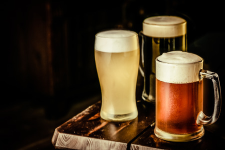 Photo pour Selection of different types of beer in glasses in pub background - image libre de droit