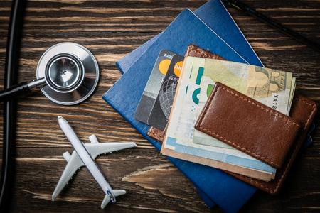 Foto de Medical tourism concept - passports, stethoscope, airplane, money - Imagen libre de derechos