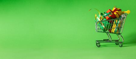 Photo pour Online shopping concept - trolley cart full of presents - image libre de droit