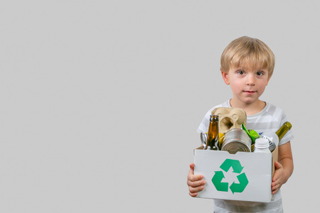 Photo for Boy holds box with recyclable materials - Royalty Free Image