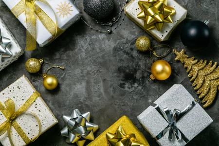 Foto de Christmas concept - silver and gold presents with confetti and ribbon - Imagen libre de derechos