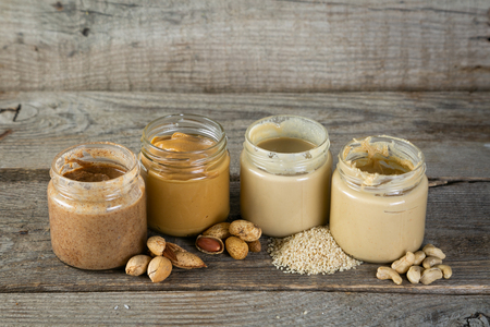Photo for Selection of nut butters - peanut, cashew, almond and sesame seeds - Royalty Free Image