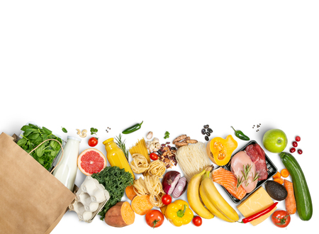 Photo pour Grocery shopping concept - foods with shopping bag - image libre de droit