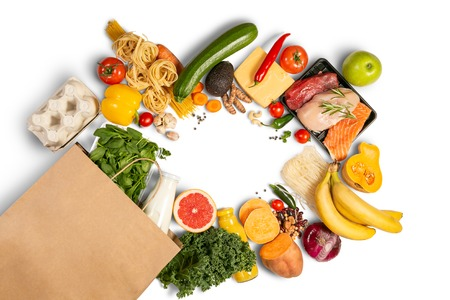 Foto de Grocery shopping concept - foods with shopping bag - Imagen libre de derechos