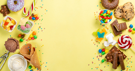 Photo pour Selection of colorful sweets - chocolate, donuts, cookies, lollipops, ice cream - image libre de droit
