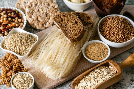 Foto per Gluten free diet concept - selection of grains and carbohydrates for people with gluten intolerance, copy space - Immagine Royalty Free