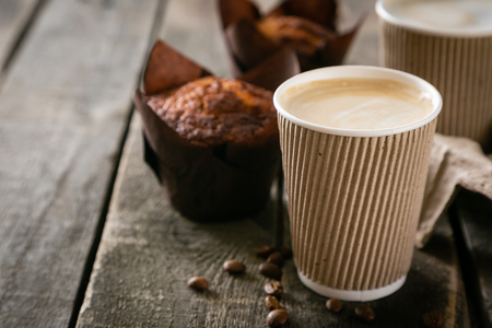 Foto für Coffee to go with muffin on wood background, copy space - Lizenzfreies Bild