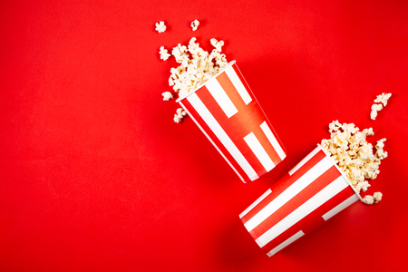 Foto per Movie night concept - pop corn, glasses, bright red - Immagine Royalty Free
