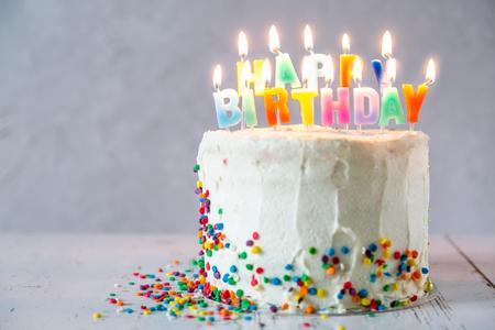 Photo pour Colorful birthday concept - cake, candles, presents, decorations - image libre de droit