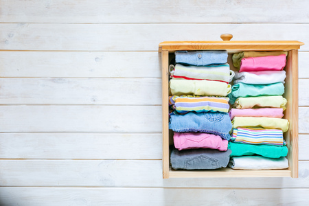 Photo for Marie Kondo tyding up method concept - folded clothes - Royalty Free Image