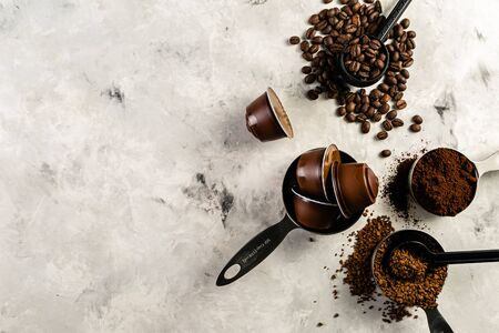 Foto de Coffee concept - beans, ground, instant, capsules marble background top view - Imagen libre de derechos