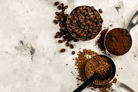 Photo pour Coffee concept - beans, ground, instant, capsules marble background top view - image libre de droit