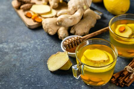 Foto de Fall immune system booster - ginger and turmeric tea and ingredients - Imagen libre de derechos