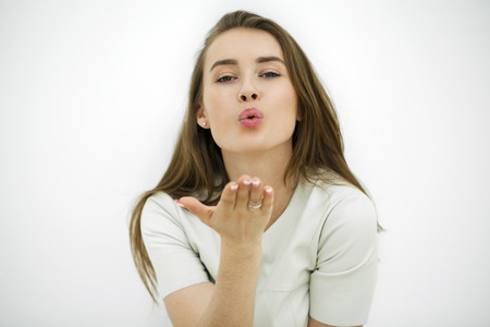 Photo for Blow kiss, young caucasian female model isolated on white background - Royalty Free Image