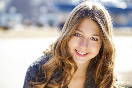 Photo for Portrait close up of young beautiful girl, on background spring street - Royalty Free Image