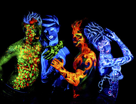 Photo pour Four elements. Body art glowing in ultraviolet light, isolated on black background - image libre de droit