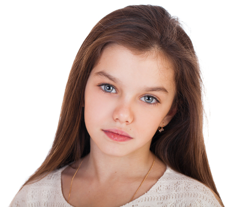 Foto de Calm brunette little girl, isolated on white background - Imagen libre de derechos
