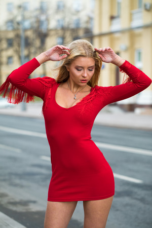 Foto de Portrait close up of young beautiful blonde woman in red sexy dress, spring street outdoors - Imagen libre de derechos